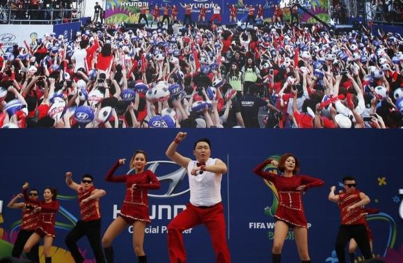 South Korean rapper Psy performs during a public screening before the 2014 World Cup Group H soccer match between South Korea and Russia, in Seoul